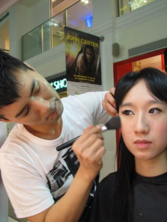 Romeo Eun applying makeup on Charlene Judith