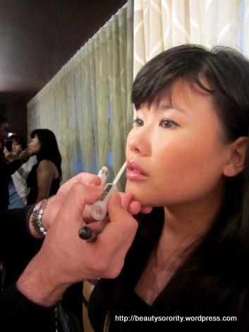 Giorgio Forgani demonstrating with Pupa makeup - lip gloss